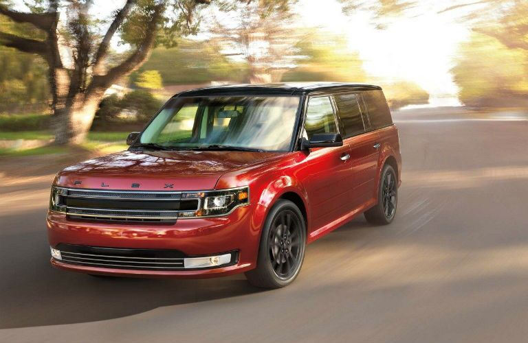 2018 Ford Flex driving during sunset