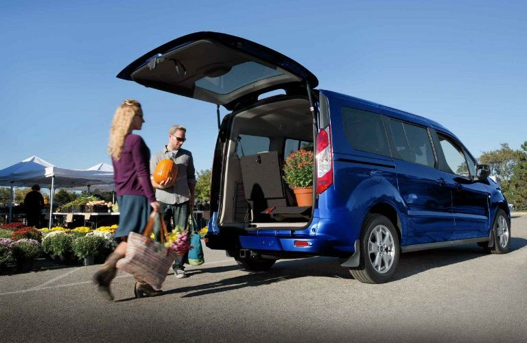 2018 Ford Transit Connect with people loading flowers