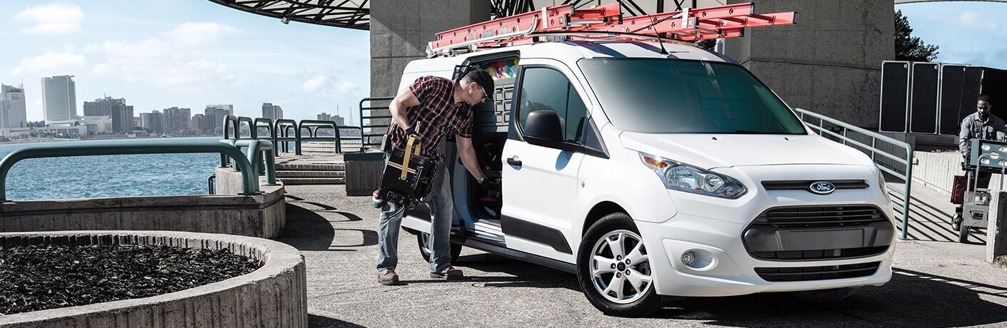 2018 Ford Transit Connect cargo van with man grabbing tools
