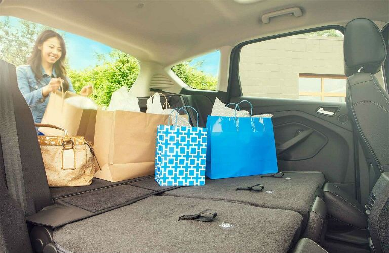 2018 Ford C-MAX Hybrid with woman loading shopping bags