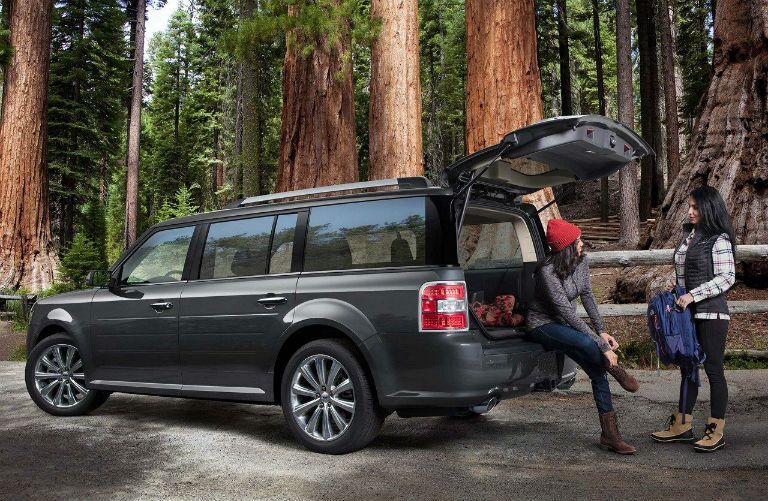 2018 Ford Flex in a forest with two hikers