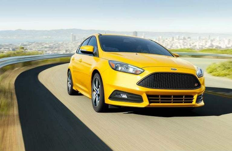 2018 Ford Focus sedan driving around a curve