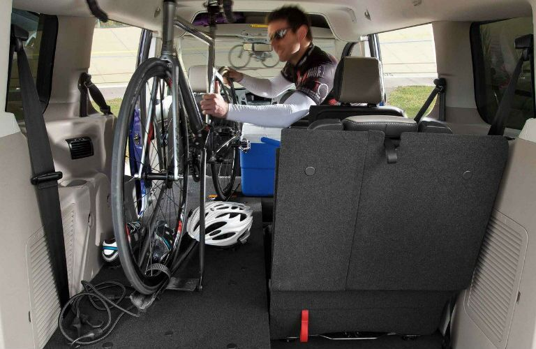 2018 Ford Transit Connect man loading a bicycle