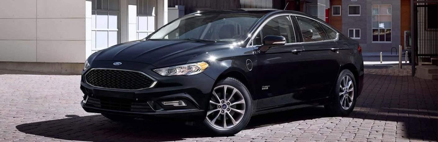 black Ford Fusion on sidewalk