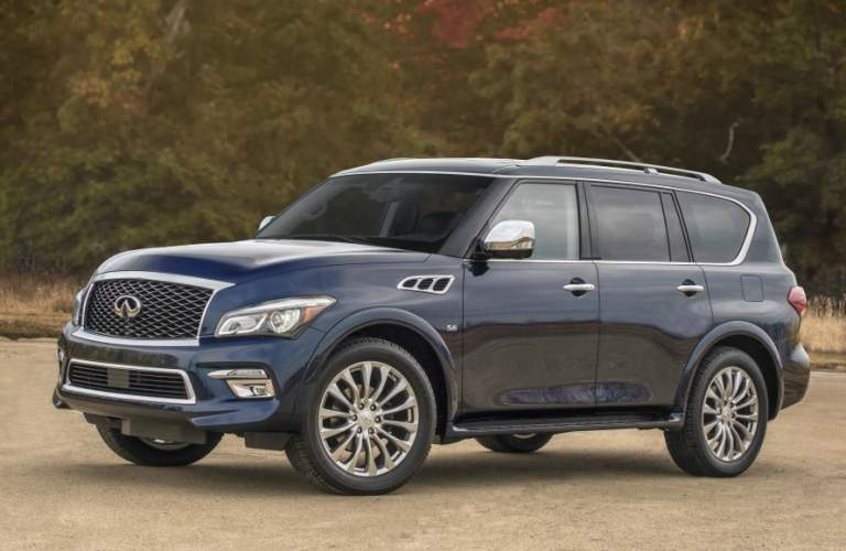 blue Infiniti QX80 front side view