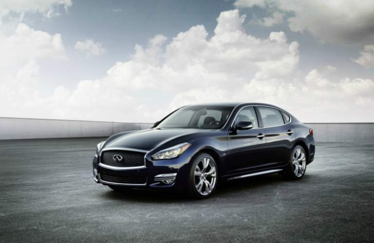 blue Infiniti Q70L front side view