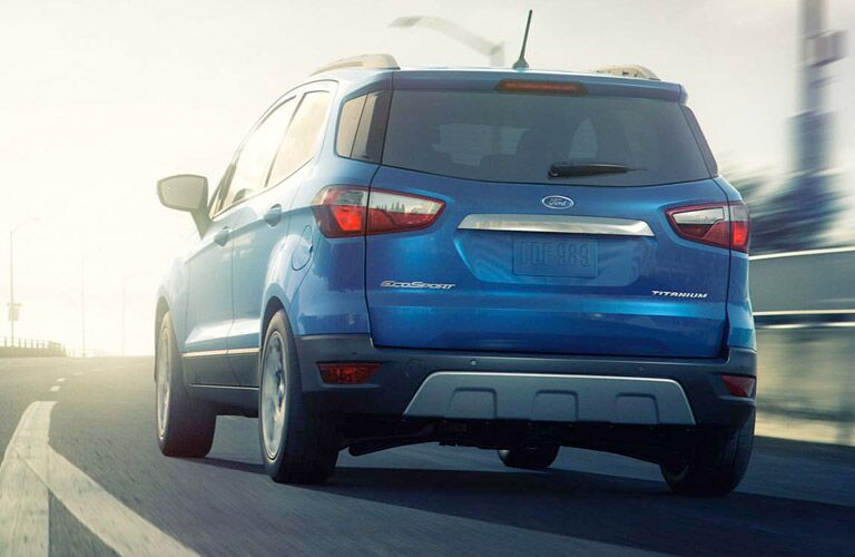 2018 Ford EcoSport driving away on a highway toward the sunset