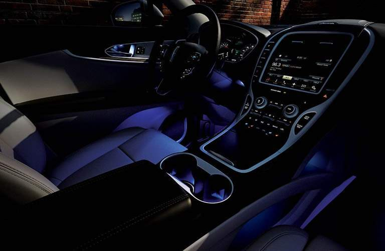 interior view of ambient lighting in the front cockpit of the 2018 Lincoln MKX