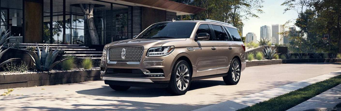 2018 Lincoln Navigator front driver side view parked outside a building