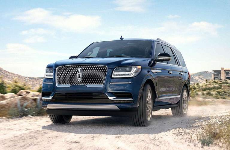 front exterior view of 2018 Lincoln Navigator in a desert environment