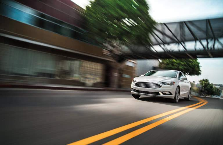 2018 Ford Fusion driving down street exterior front view