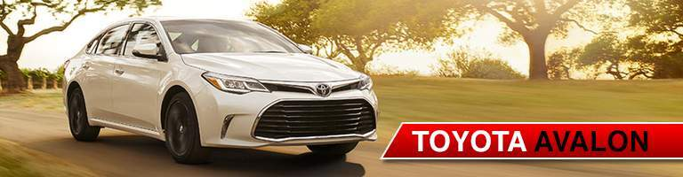 white Toyota Avalon front side view