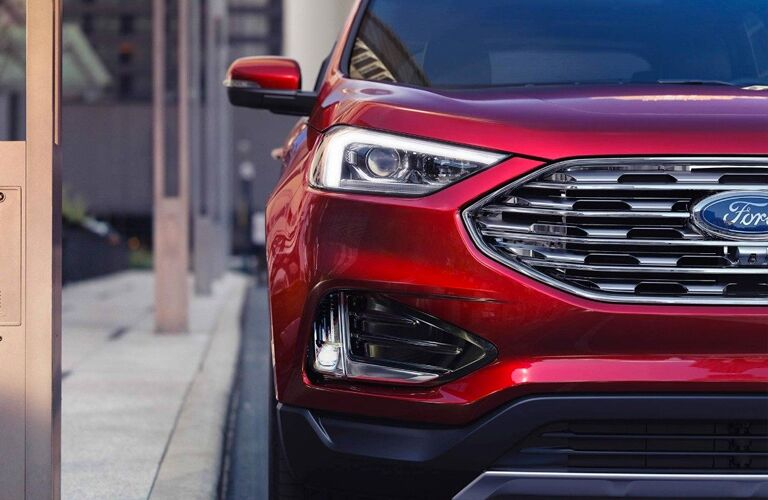 Passenger side headlight of red 2019 Ford Edge