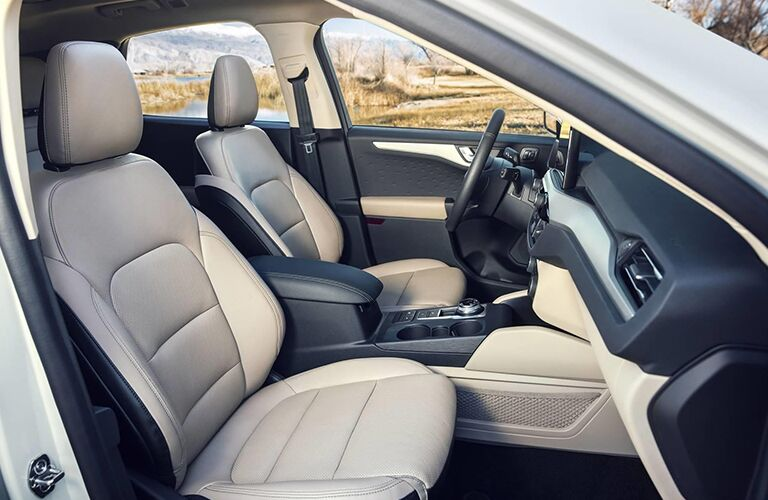 2020 Ford Escape interior side shot of front seating upholstery, steering wheel, and dashboard design and layout