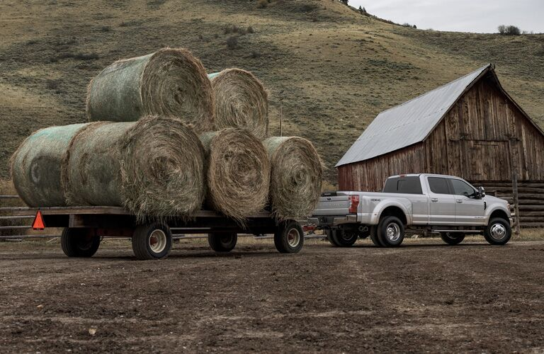 2020 Ford F-350 Super Duty pulling a massive trailer of hay