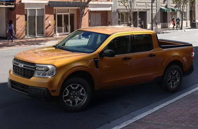 2022 Ford Maverick driving down a city street