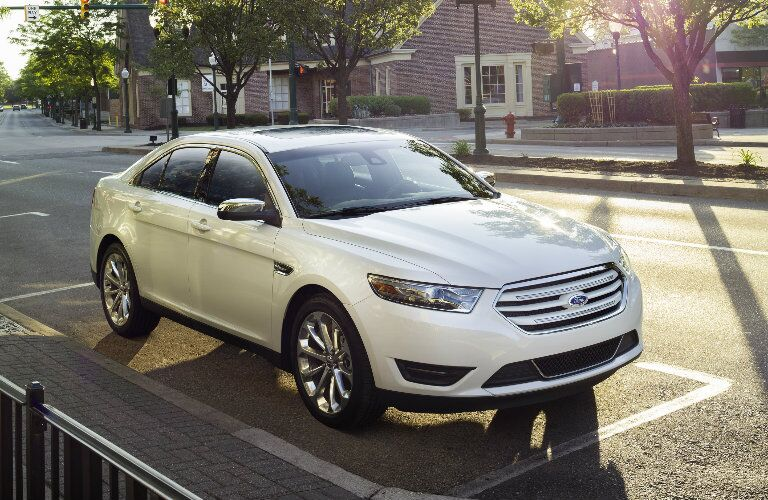 2017 Ford Taurus parked on street in white
