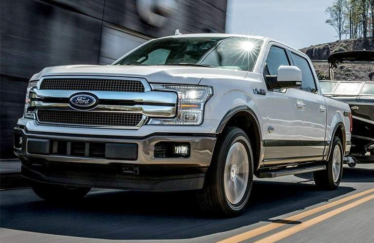 2018 Ford F-150 white towing a boat front view