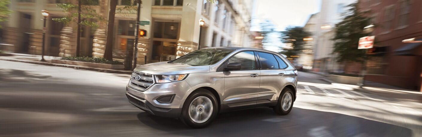 2018 Ford Edge silver side view in motion