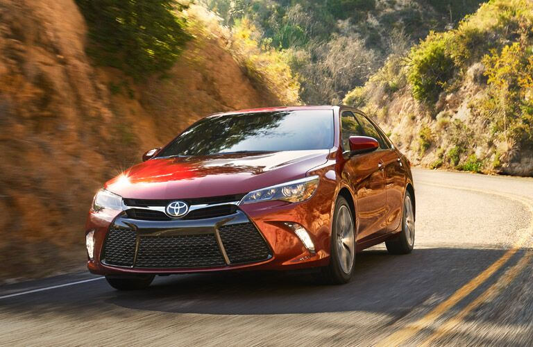 Red 2016 Toyota Camry driving