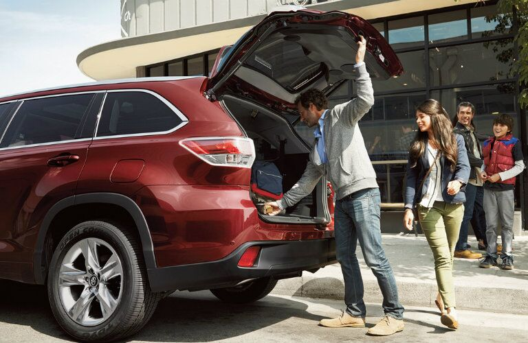 Trunk of red 2016 Toyota Highlander open