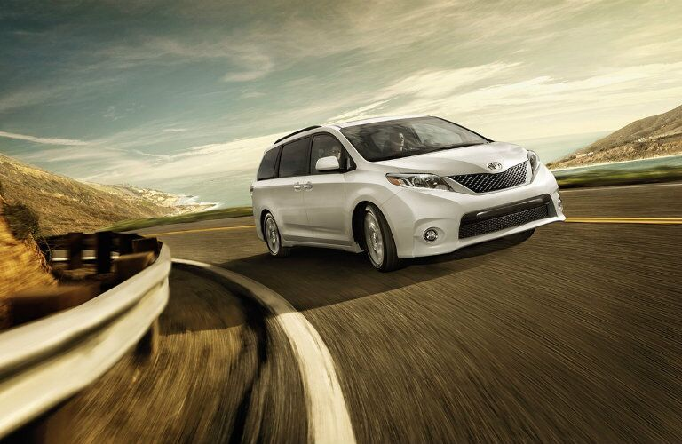 White 2016 Toyota Sienna driving down road