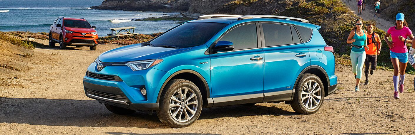 2017 Toyota RAV4 in blue parked at the beach