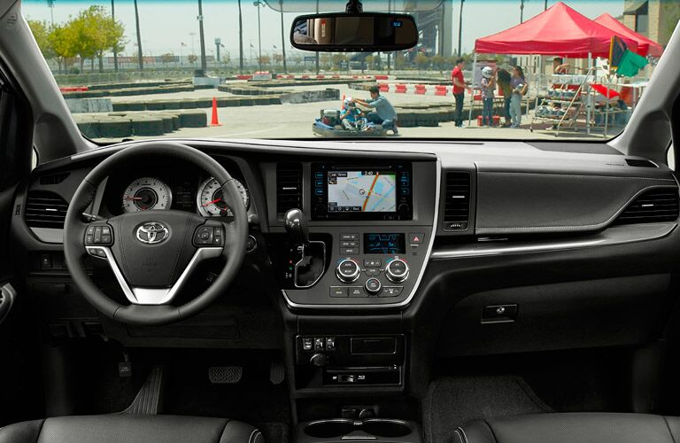 Interior View of the 2017 Toyota Sienna Steering Wheel and Center Dash in Black