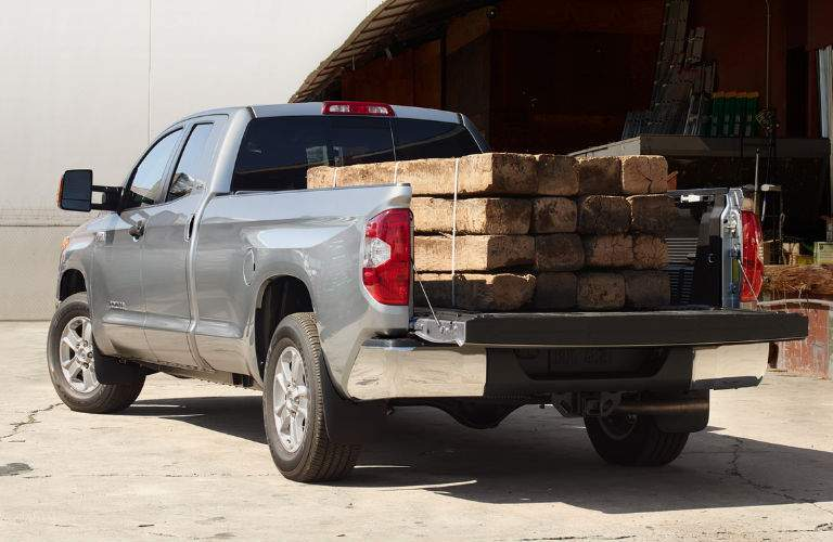 2018 Toyota Tundra with Rear Tailgate Open and Lumber Stored in the Trailer Bed