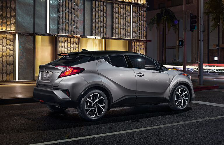 2019 Toyota C-HR in grey parked in an empty parking lot at night