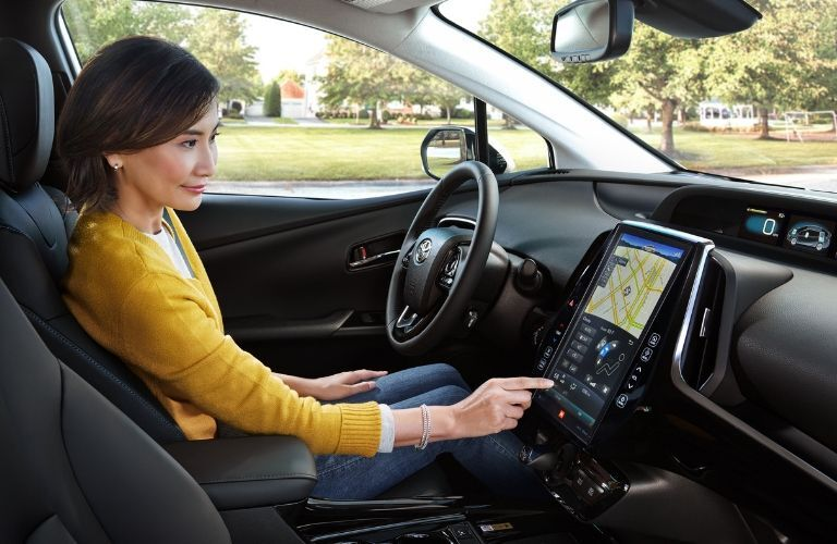 woman using touchscreen navigation in 2019 Toyota Prius