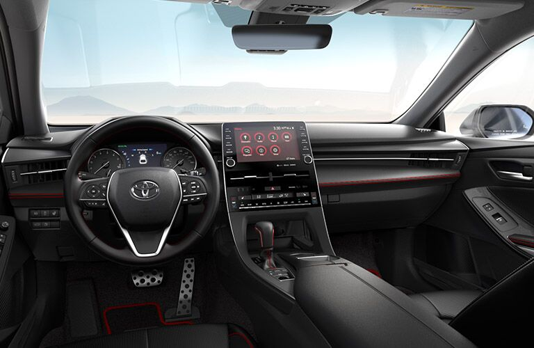 Interior view of the steering wheel and touchscreen inside a 2020 Toyota Avalon