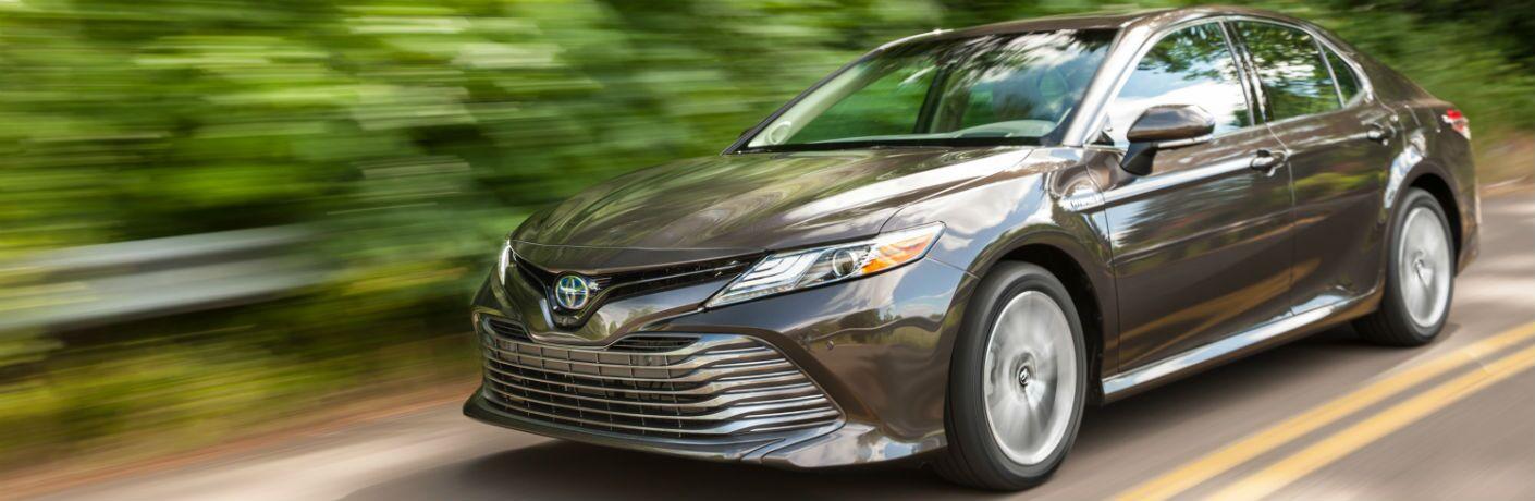 Grey 2020 Toyota Camry Hybrid driving