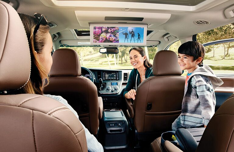 kids watching the rear seat entertainment system in the 2020 Toyota Sienna
