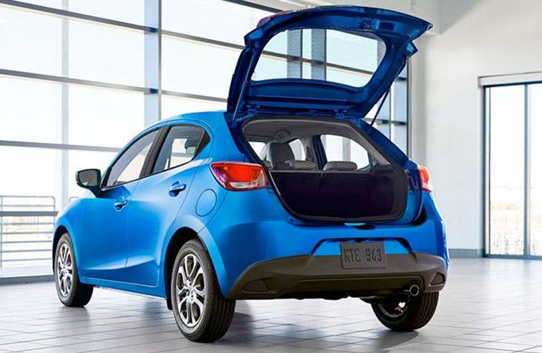 Rear view of blue 2020 Toyota Yaris Hatchback with liftgate open