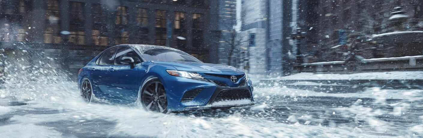 front view of a blue 2020 Toyota Camry AWD