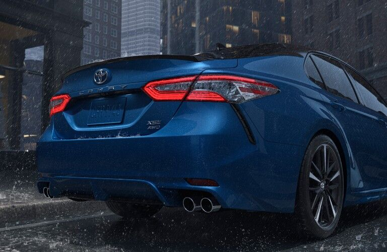 rear end of a blue 2020 Toyota Camry AWD