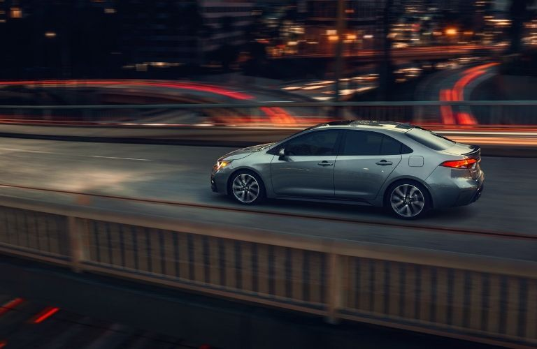 2020 Toyota Corolla crossing an overpass at night