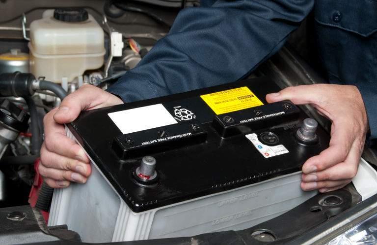 Technician Installing New Vehicle Battery