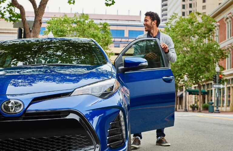 Driver getting into the 2019 Toyota Corolla