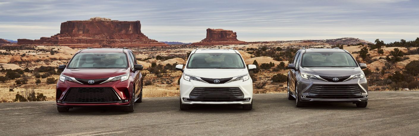 A head-on photo of three 2021 Toyota Sienna on a road.