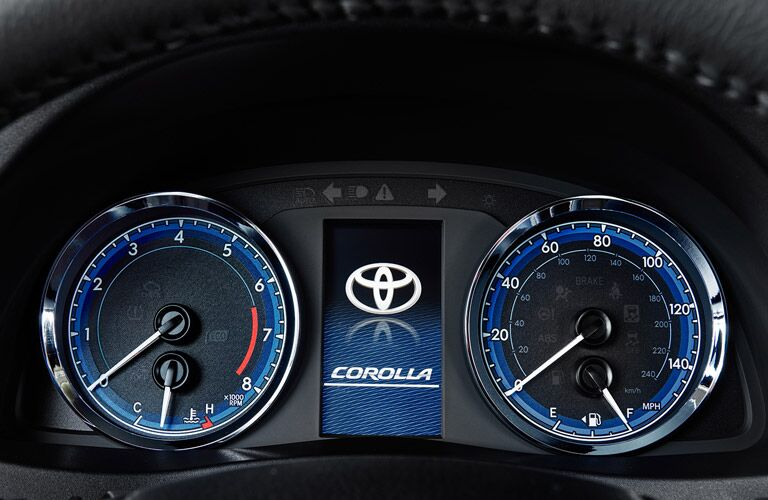 A photo of the center gauge cluster in the Toyota Corolla.