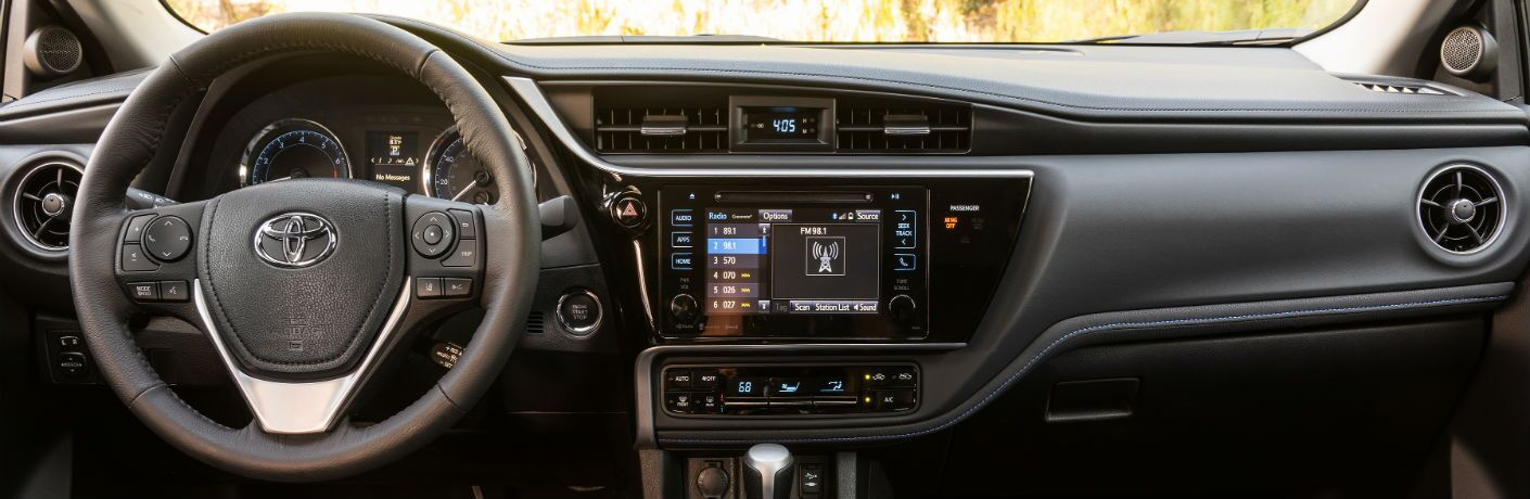 A photo of the dashboard in the certified pre-owned Toyota Corolla.