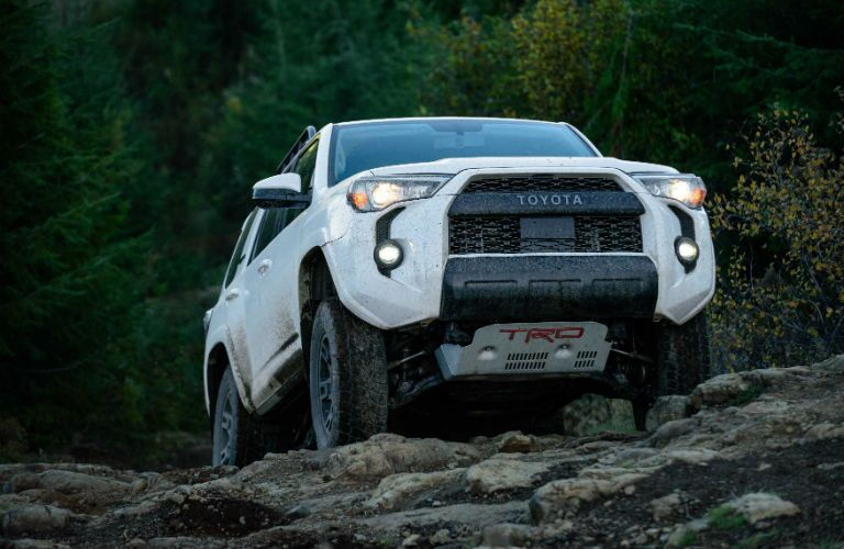 A photo of the 2020 Toyota 4Runner coming over a rock hill.