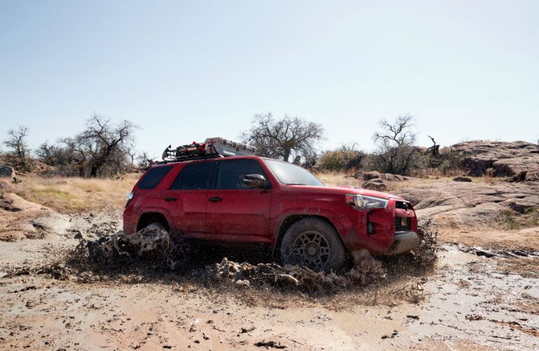 A photo of the 2020 Toyota 4Runner driving through deep mud.