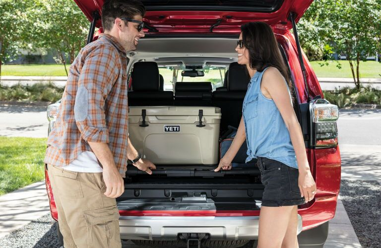 A photo of people unloading cargo from the back of the 2020 Toyota 4Runner.