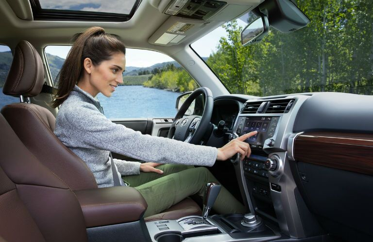 A photo of a person using the technology in the 2020 Toyota 4Runner.