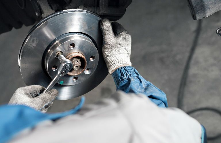 Service Rep Working on Brake