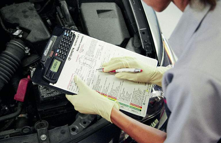 Toyota Technician Inspecting a Vehicle For Customer