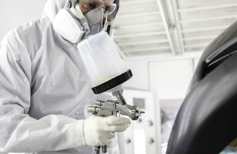 Toyota Technician Giving New Paint Job to Toyota Model
